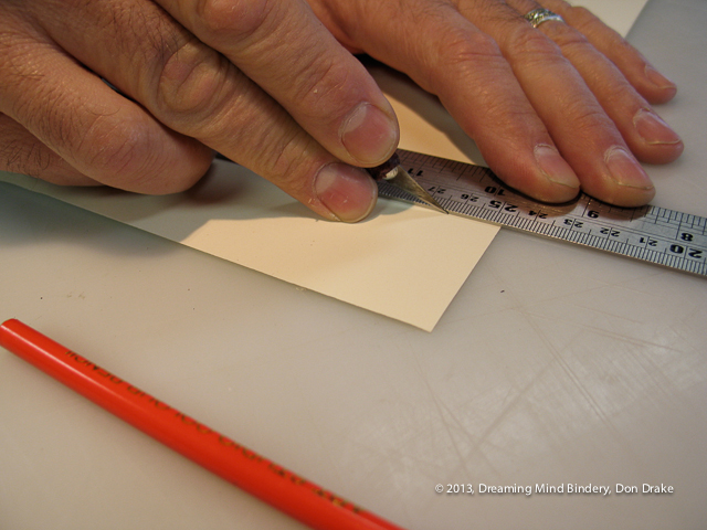 A close showing good technique in the use of a knife when cutting paper