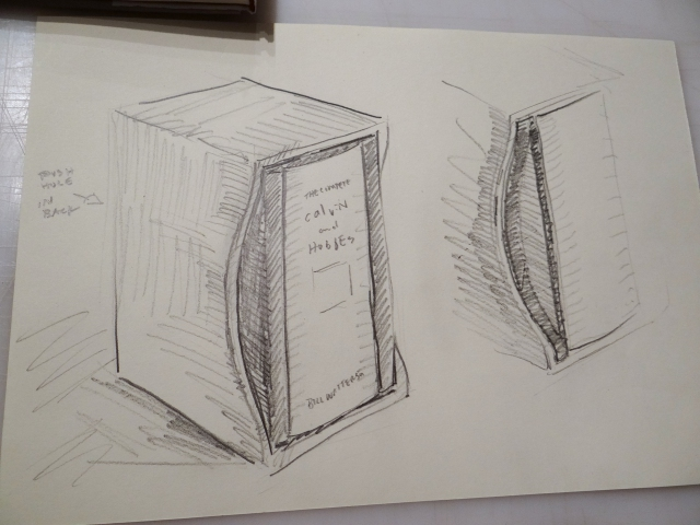 Sketch of a slipcase design with an additional wrapper that doubles as a support cradle