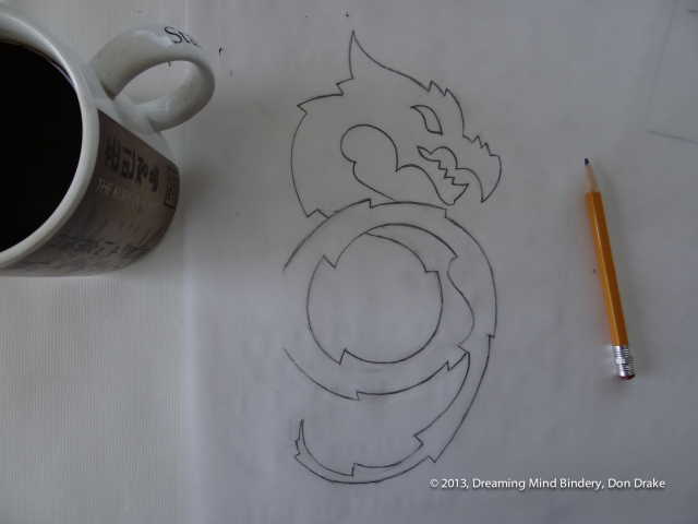 The final sketch for a dragon design to be turned into a copper journal cover.