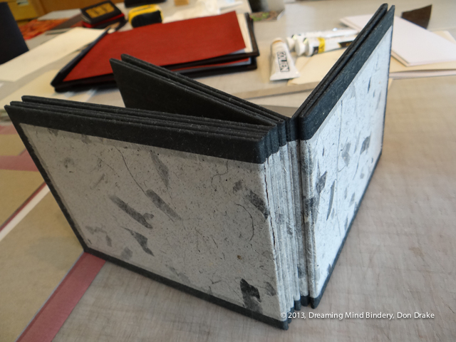 The spine of an accordion board book that uses magnets in the spine to simulate a bound book structure