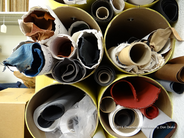 The ends of various rolls of bookbinding materials.