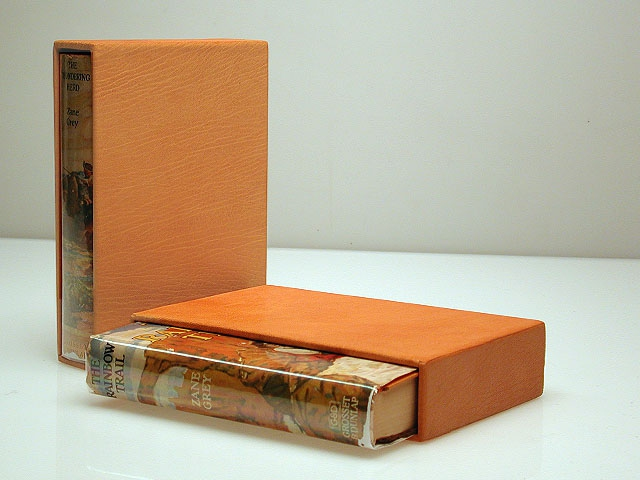 Two nice copies of Zane Grey in leather slip cases