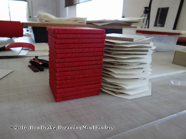Red and white covered panels for the content portion of Partially finished boxes for Don Drake's edition 'Global Warming Survival Kit'