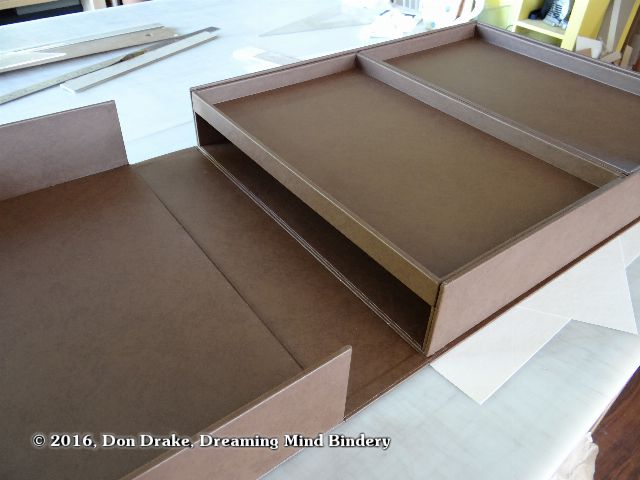 The interior of Oliver Klink's clamshell box showing the two removable trays in place