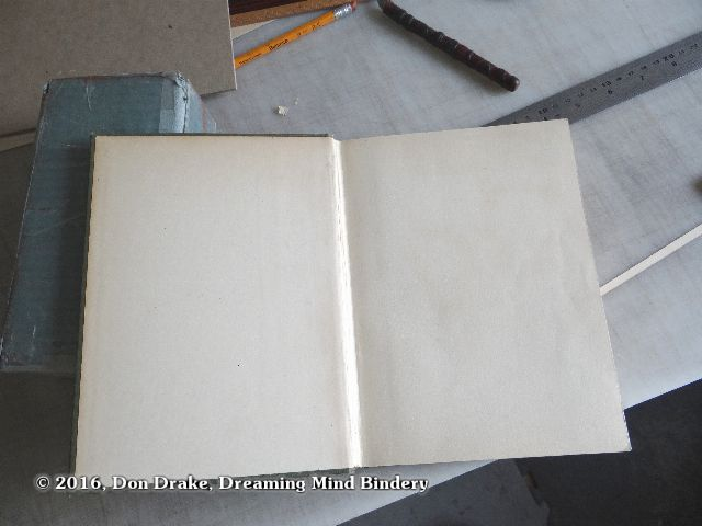 The replacement end papers in a restored book.