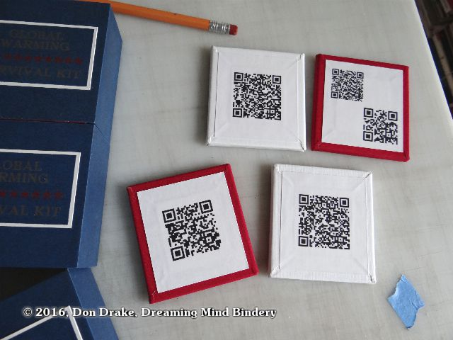 B-sides of the 4 panels in Don Drake's Global Warming Survival Kit showing the QR code content