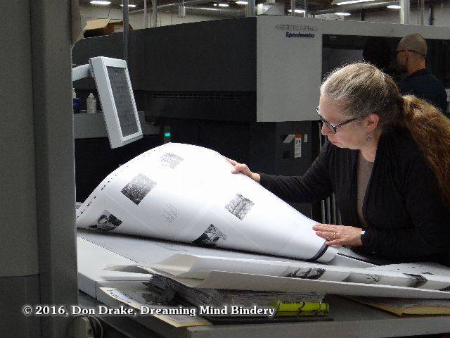 Kate Jordahl checking a press sheet for the One Poem Books #5 & 6