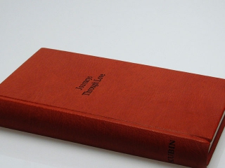 A full leather binding of poetry, created for the author as a Valentin's Day gift for his wife.